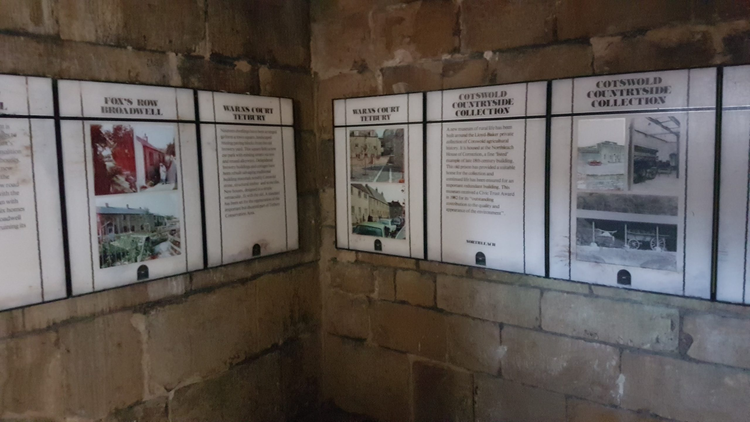 Interpretative panels on the walls of the cells.