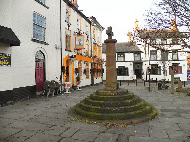 Altrincham Market Cross and Old Market Place. The cross is a replica or the original, which stood outside the Butter Market. The lock-up was located here.