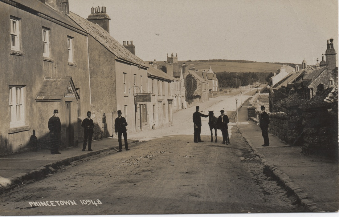 Postcard, undated, featuring a sepia photograph of members of the Devon Constabulary standing outside the Old Police Station.