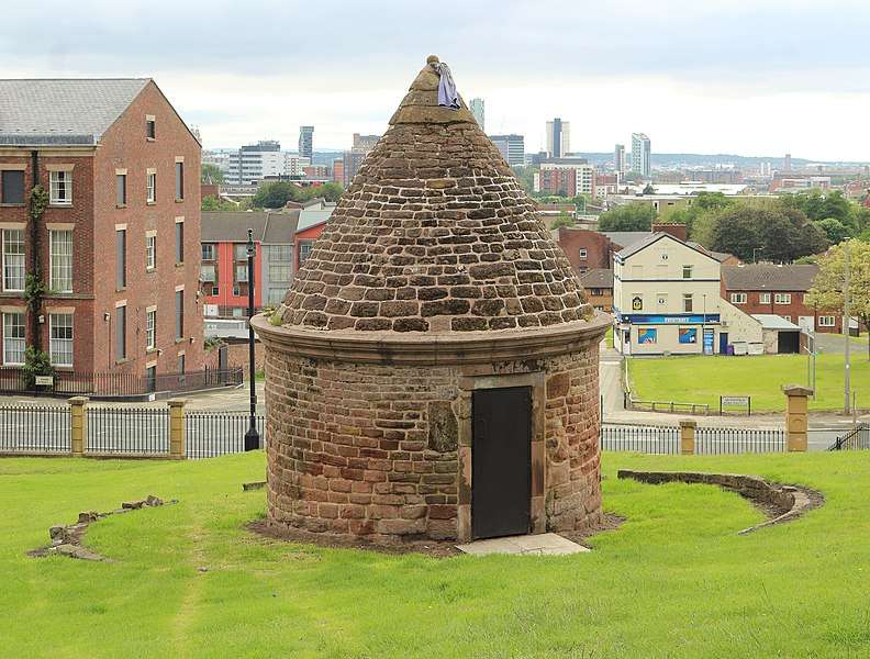 Grade II listed former overnight lockup for drunks. Behind are Shaw Street and beyond, Liverpool Waterfront buildings.