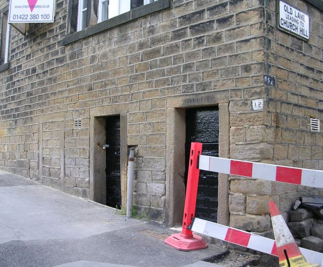 Exterior, showing the corner of the building (junction of High Street and Old Lane, and cell doors painted black (c.2008)
