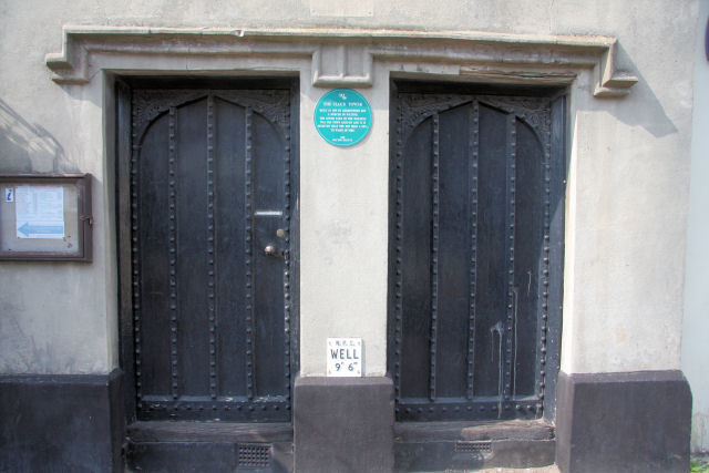 Close up of cell doors, with blue plaque