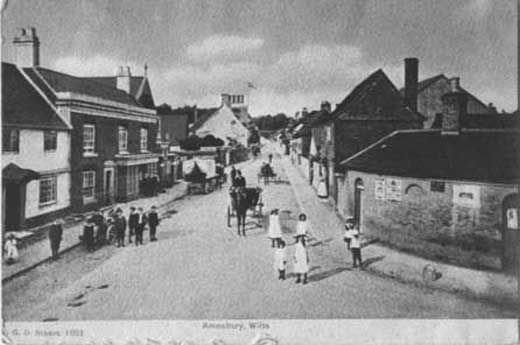 Postcard, looking north along High Street with the lock-up in the right foreground and Sandell's leather shop on the left, Amesbury, Wiltshire 1900-1907