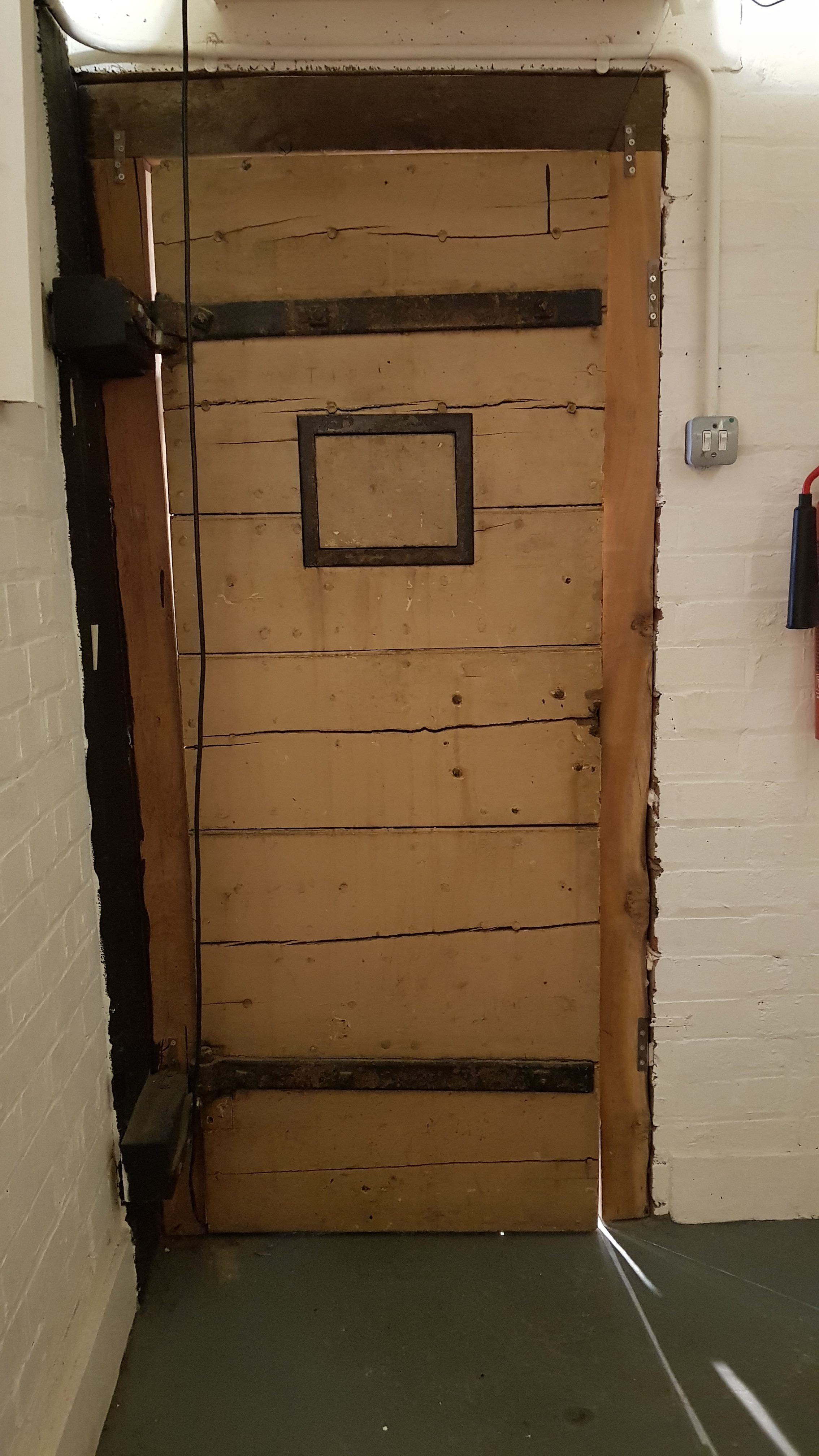 Back of cell door from Great Dunmow Police Station, now at Essex Police Museum