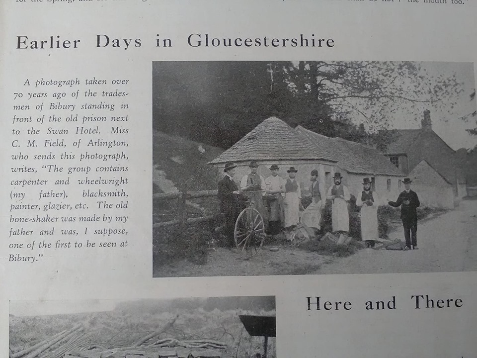 A group of tradesmen posing for a photograph in front of Bibury lock-up, late 19th century. It is not known whether the lock-up was still in use at this time.