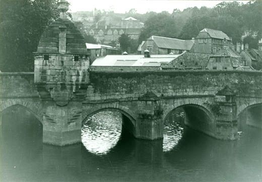 Photograph, view of town with bridge in foreground, Bradford on Avon, Wiltshire, 1930s. No extra info on Lock-up on photo database.