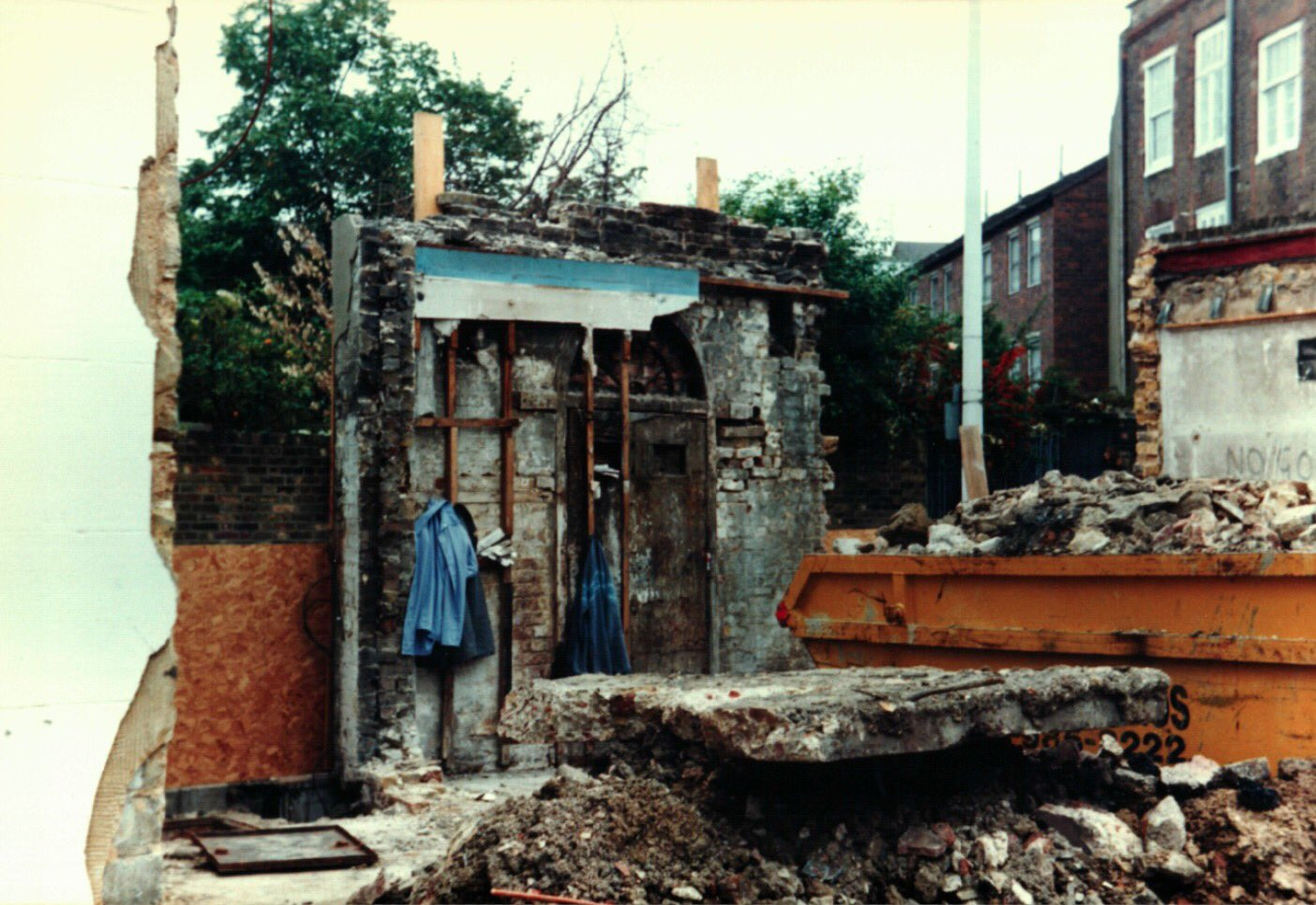 Demolition of the buildings surrounding the lock-up, and the rear of the lock-up. Only the original facade remains.