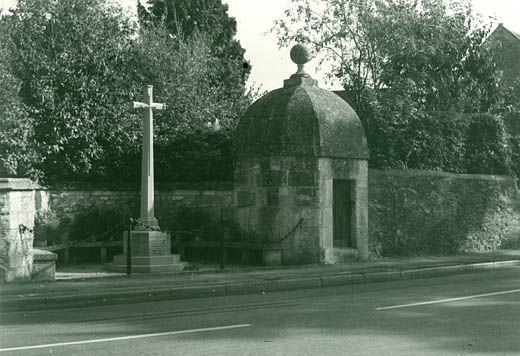 Photograph, lock-up and War Memorial, Hilperton, Wiltshire, September 1983