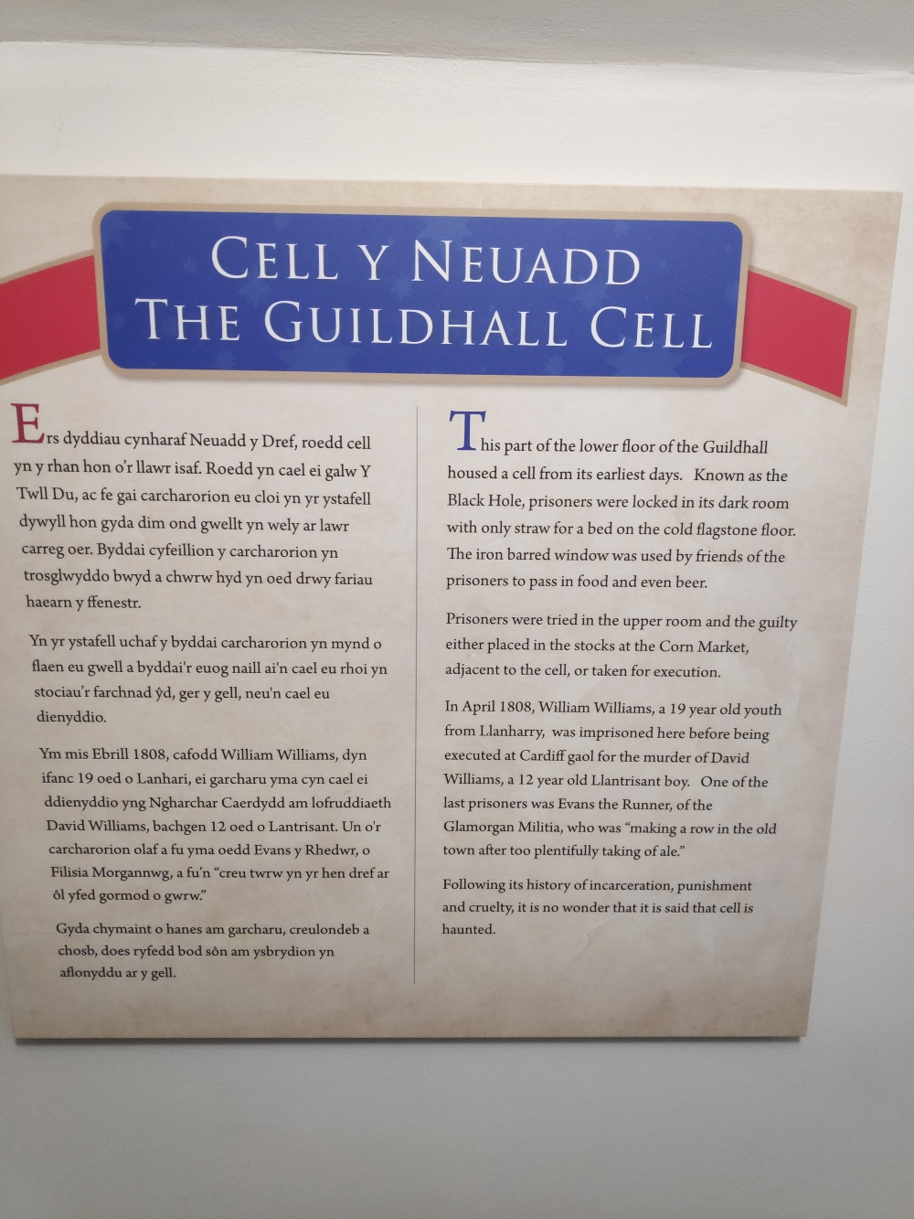 Information board, giving the history of the cell (or Black Hole) in the Guildhall (August 2019)
