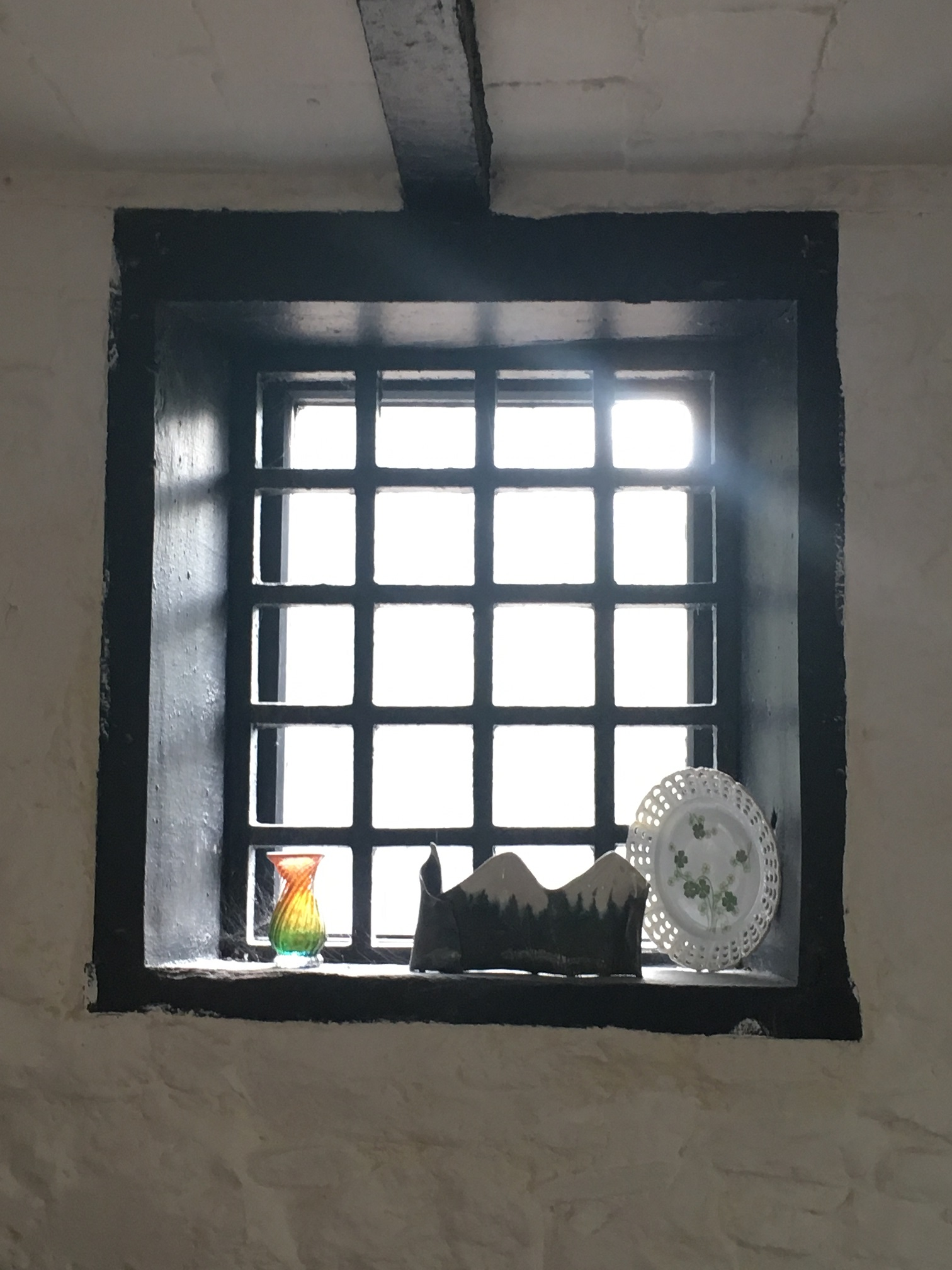 'New' window with original bars. The bars were moved to this window during a side extension to the house. The old window was demolished.