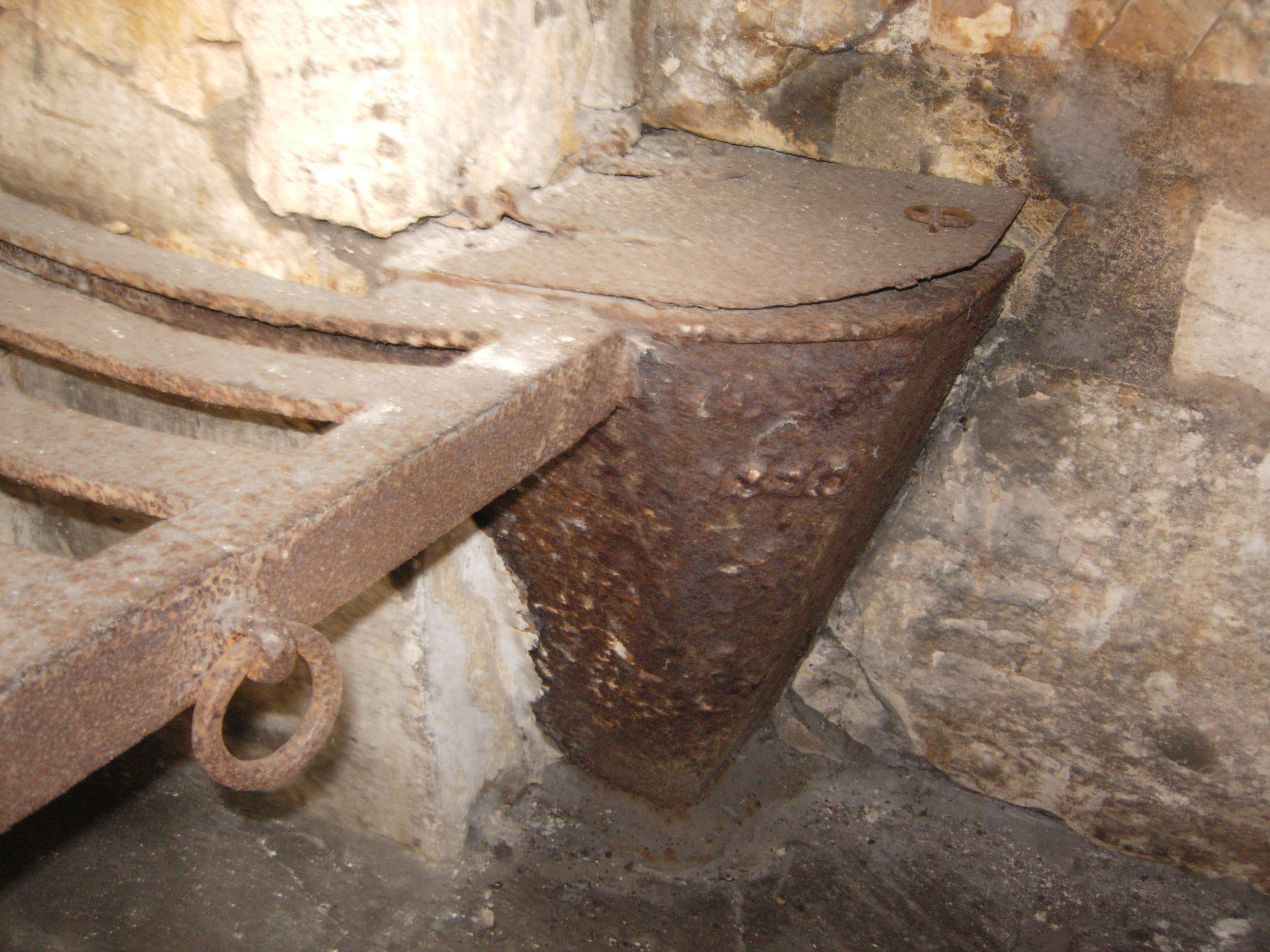 Lock-up interior, showing the toilet (or hopper) located at the end of the bed frame. The hopper was connected to a chute which deposited waste into the river.