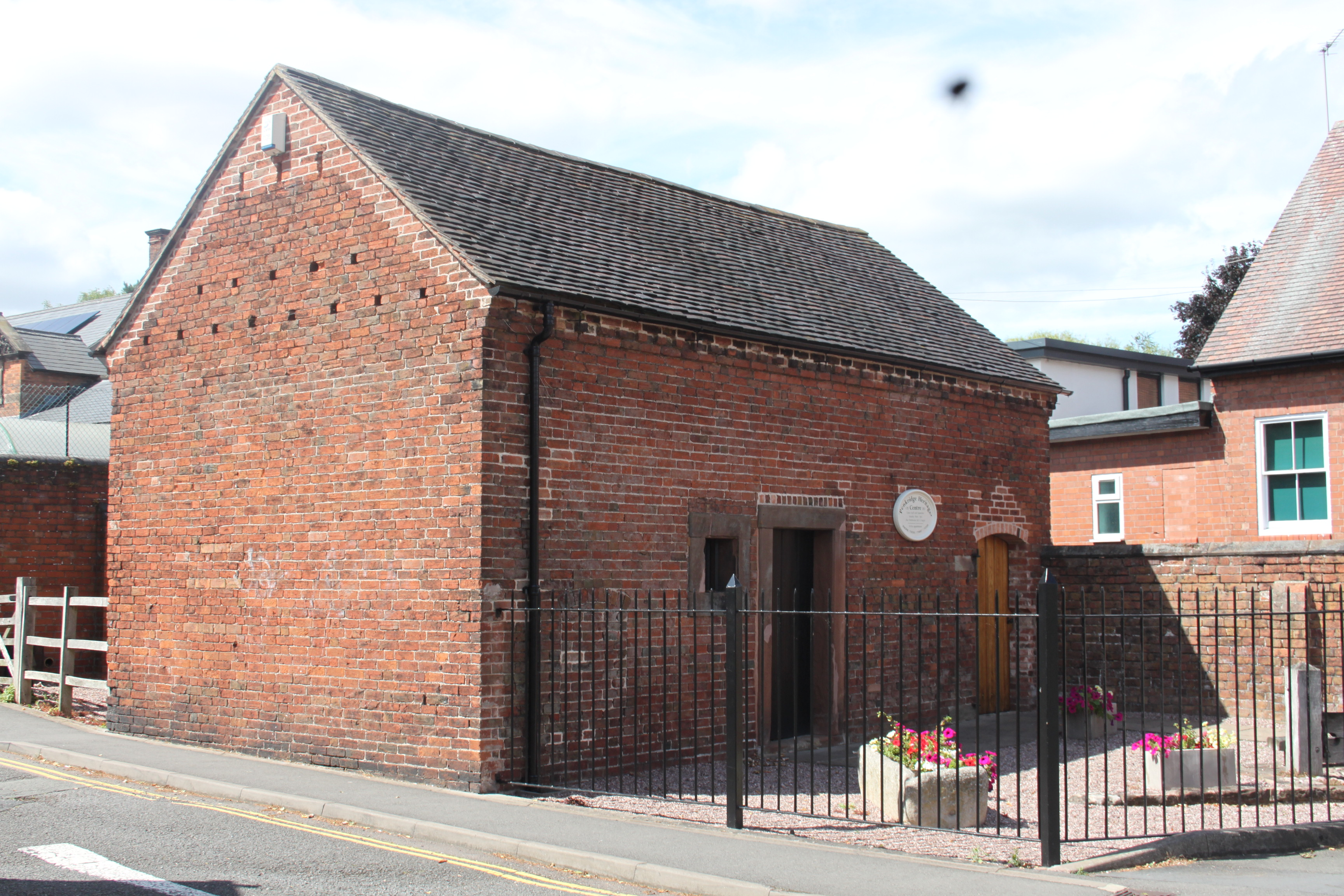 Penkridge Gaol, now Heritage Centre, entrance. The old village stocks can be seen in the right-hand corner.