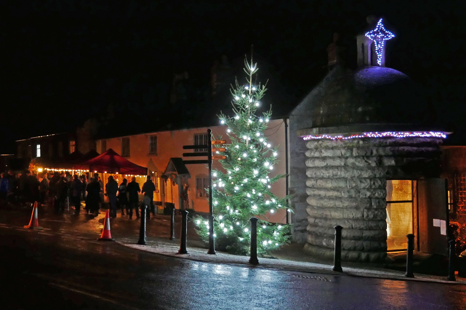 Alton Round House decorated for Christmas. Each year, a nativity scene is installed inside the lock-up. The Round House is used as the centre point for community carol singers, led by the local (Alton) Handbell Ringers