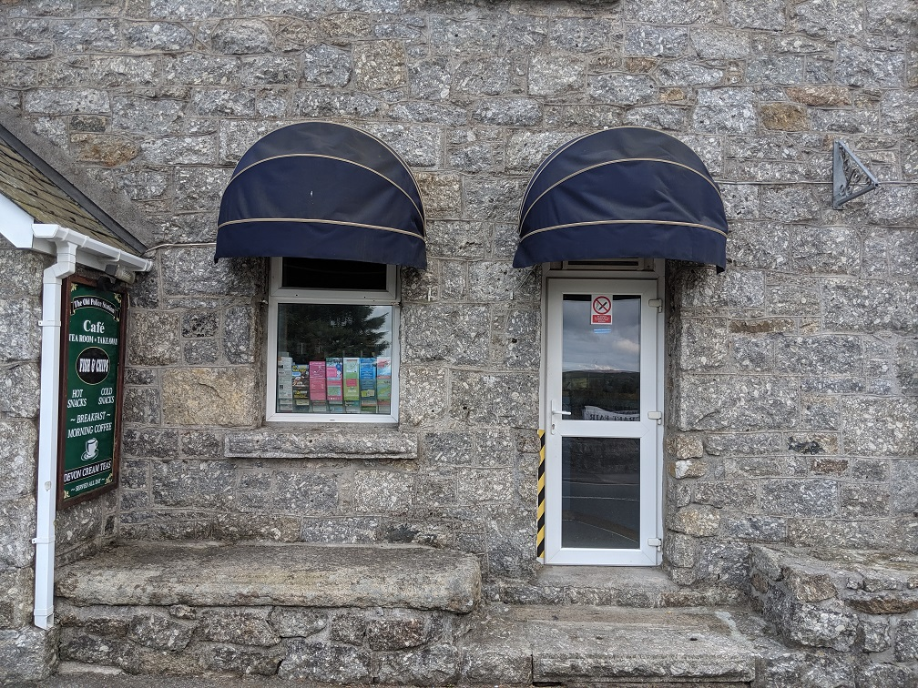 Probable cell window to the right of the door, and to the left of the current main entrance to the cafe