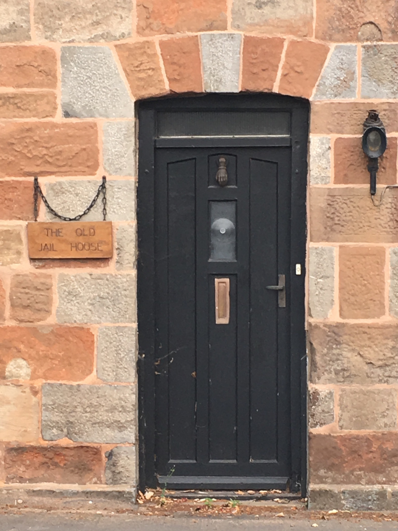 Close up of entrance with plaque, 'The Old Jail House'