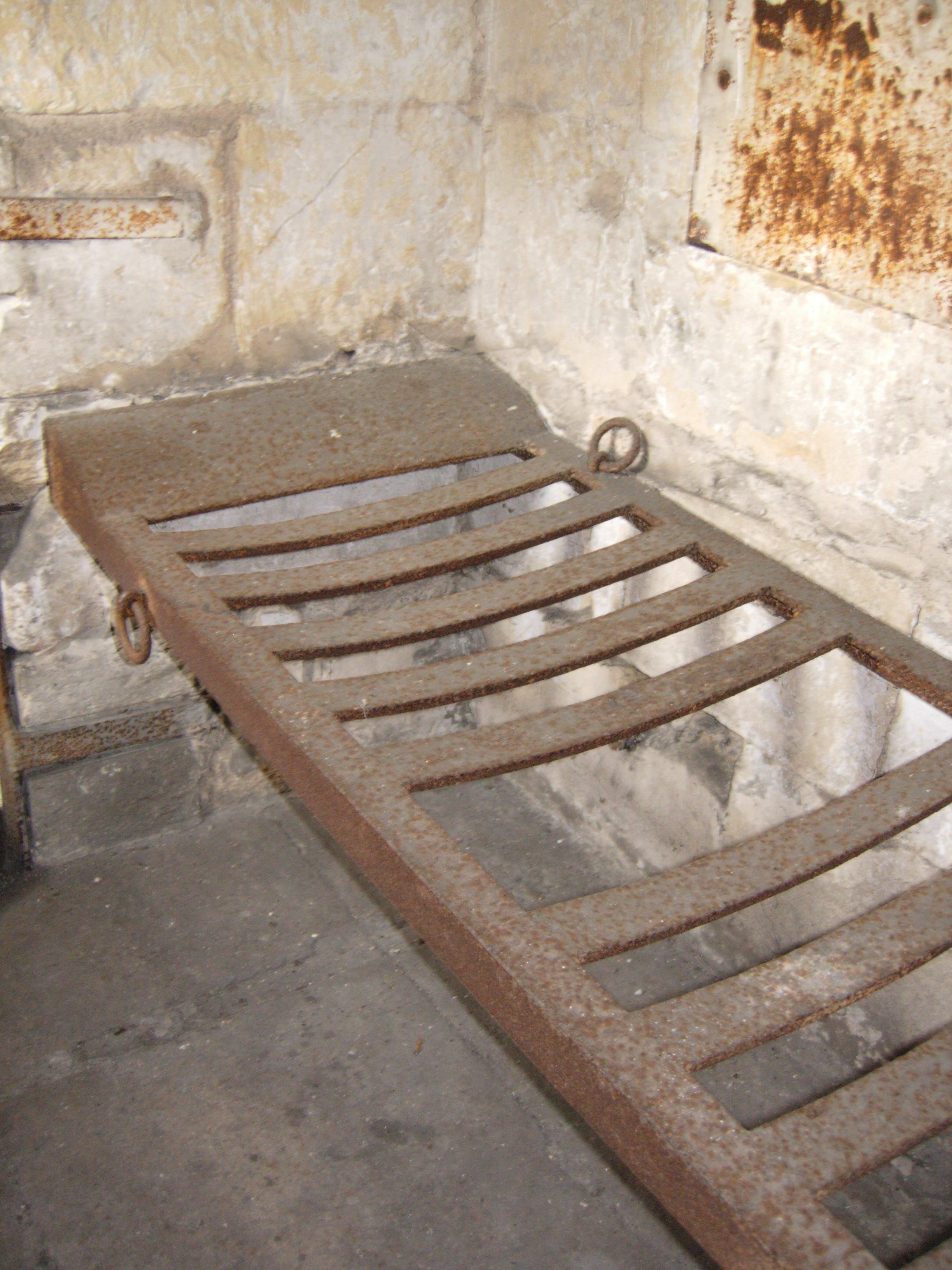 Lock-up interior, showing the iron bed frame in the south cell