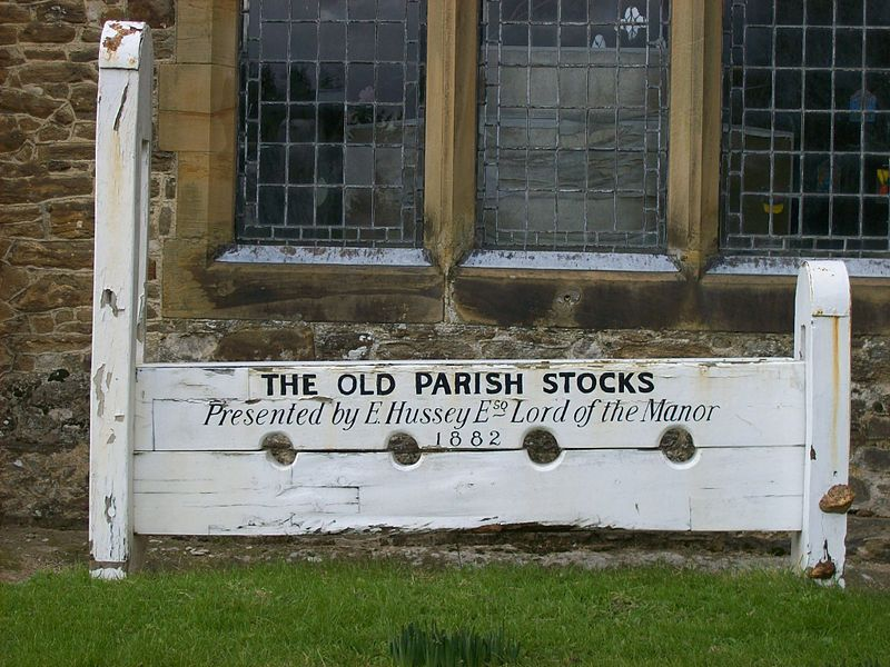 Village stocks in the churchyard of St Michael and All Angels, Marden