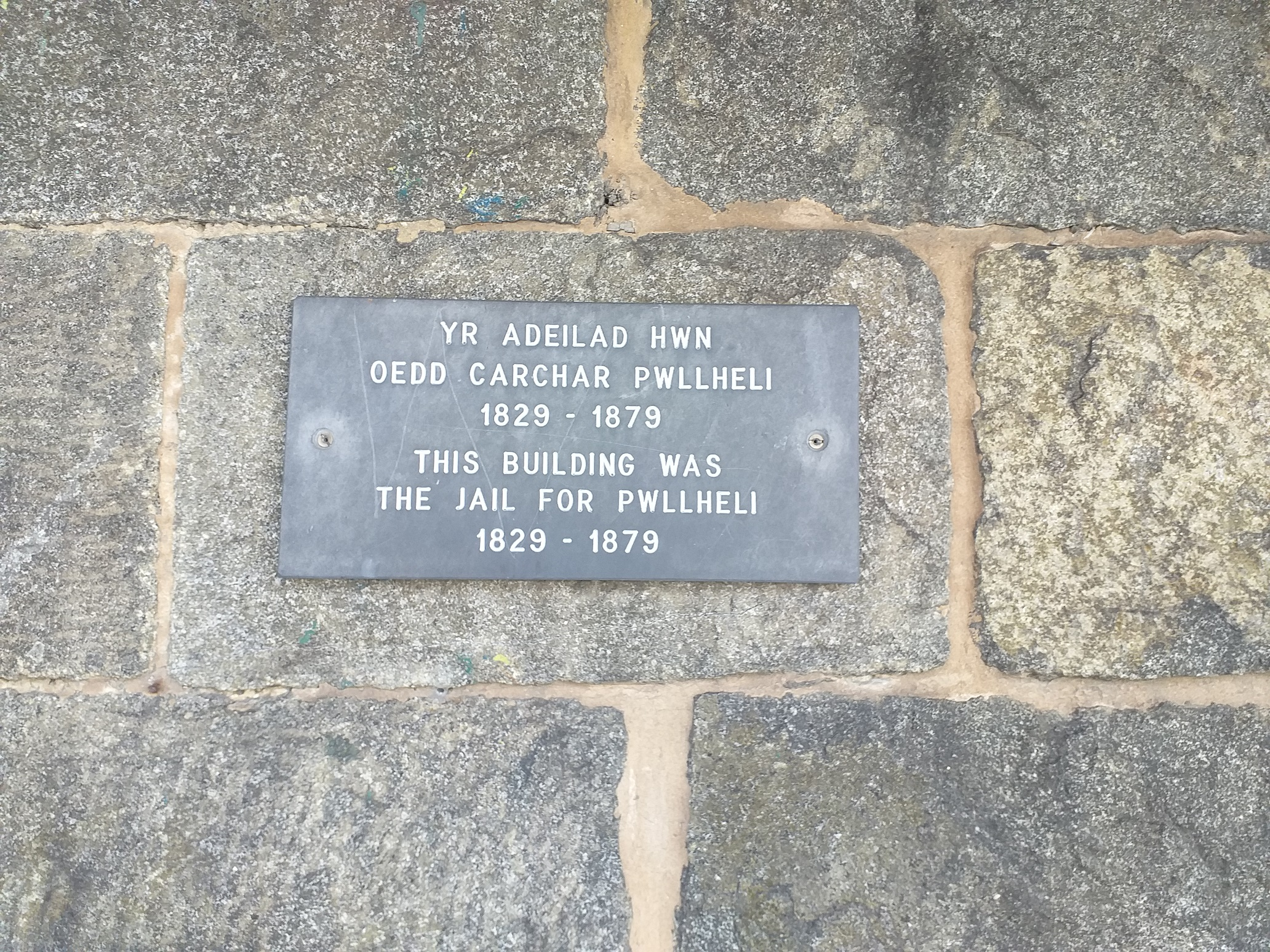 Plaque on the front of the building noting its former use (with dates)