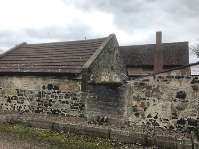 Taken from outside the perimeter wall of The Salmon. These walls look very old. Lock up would be to right. There is a small building on the position of Lock Up but inner walls are brick and only external wall is stone so it might have replaced Lock Up.