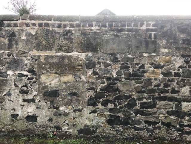 Possible surviving external wall of the Lock Up. If not, then it was adjoining the latter. It is located directly opposite the Court House. Evidence of earlier openings, now blocked up, remains visible.
