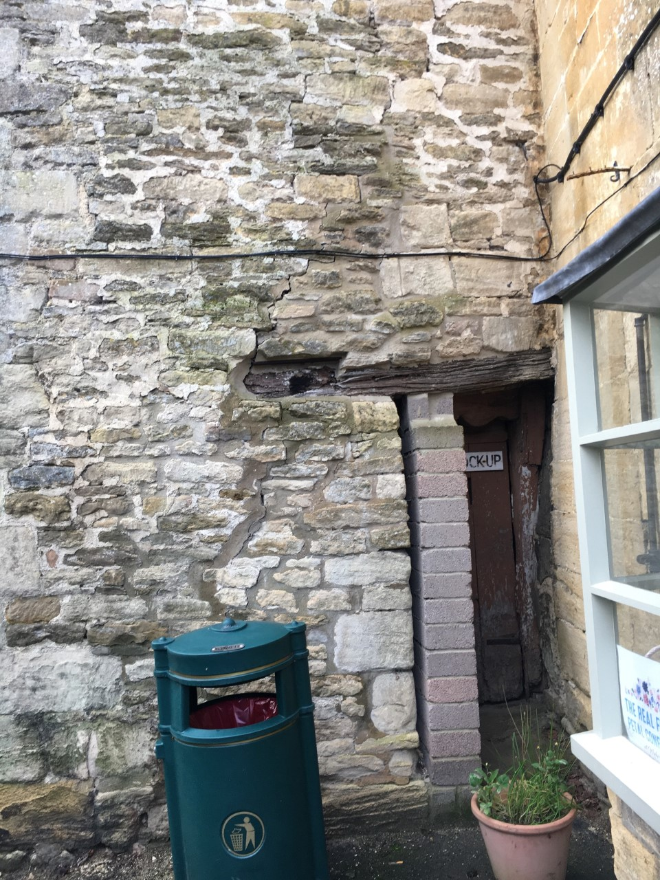 Entrance to the lock-up, in December 2019. A column of breeze blocks now obscures the entrance. This was installed for support after movement in the outside wall.
