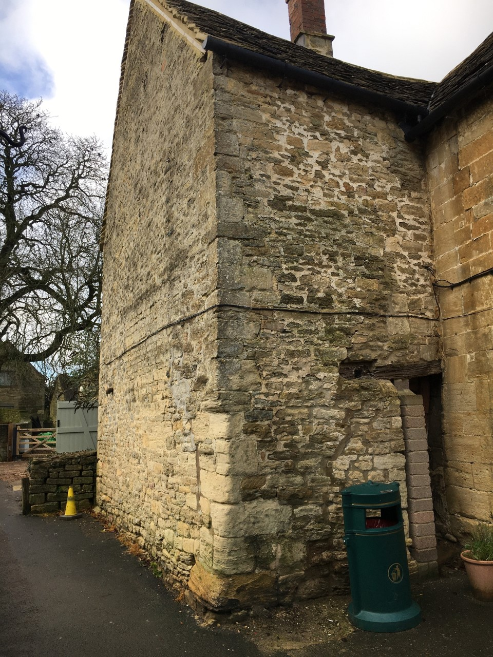 View from the Square of the side wall and path up towards the church (December 2019)